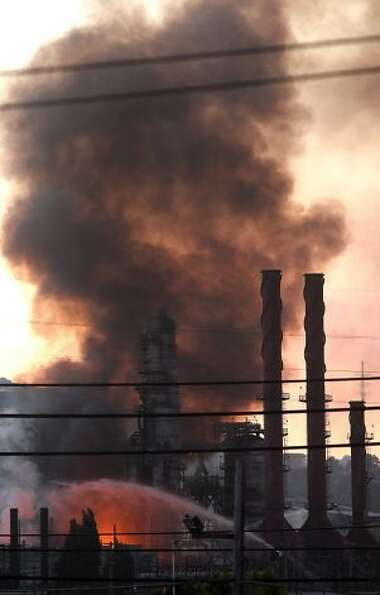Crews fight the fire at the Chevron refinery. The fire reportedly started at the No. 4 Crude Unit. P