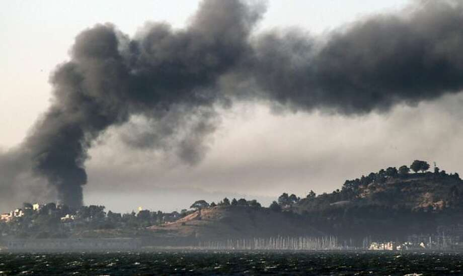 Smoke from the Chevron refinery fills the sky above Richmond after a series of explosions beginning around 6:15 p.m. No one was killed, Chevron said. Photo: Lance Iversen, The Chronicle / SF