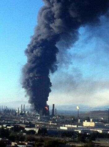 A fire in is seen at the Chevron Refinery in Richmond, Calif. Photo: Courtesy Tom Butt / SF