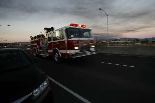A fire engine drives on Castro Street toward the Chevron Oil Refinery fire in Richmond, Calif. on Monday, Aug. 6, 2012. Photo: Stephen Lam, Special To The Chronicle / SF