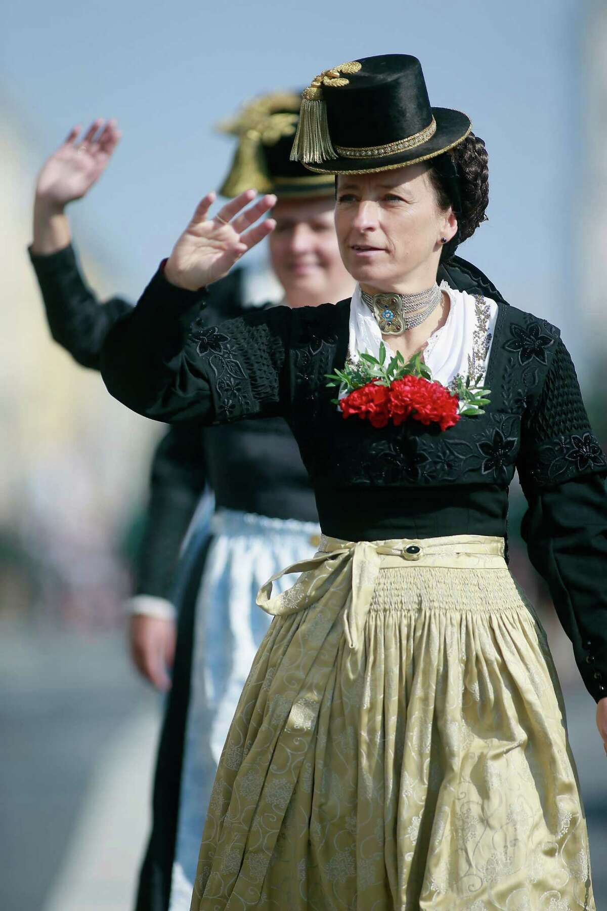 MUNICH, GERMANY - SEPTEMBER 23: Traditional Bavarian dressed women participate in the riflemen's parade during day 2 of the Oktoberfest beer festival on September 22, 2012 in Munich, Germany.This year's edition of the world's biggest beer festival Oktoberfest will run until October 7, 2012.