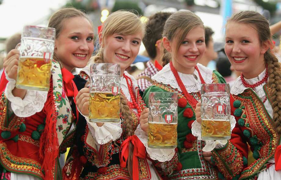 MUNICH, GERMANY - SEPTEMBER 23:  Polish girls, dressed with traditional Polish costume enjoy drinking beer after participating in the opening parade during day 2 of Oktoberfest beer festival on September 22, 2012 in Munich, Germany.This year's edition of the world's biggest beer festival Oktoberfest will run until October 7, 2012. Photo: Johannes Simon, Getty Images / 2012 Getty Images