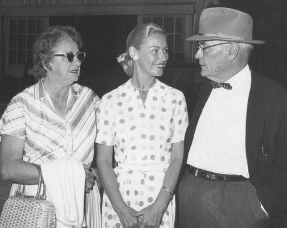 "From the June 4, 1964, Houston Post: ""These people may shed a tear at the Pin Oak Horse Show tonight: Mr. and Mrs. Ash Robinson and their daughter, Joan Robinson Hill, center. Joan's great show horse, 'Precious Possession,' will be retired tonight in impressive ceremonies at the show."" (Post file)"