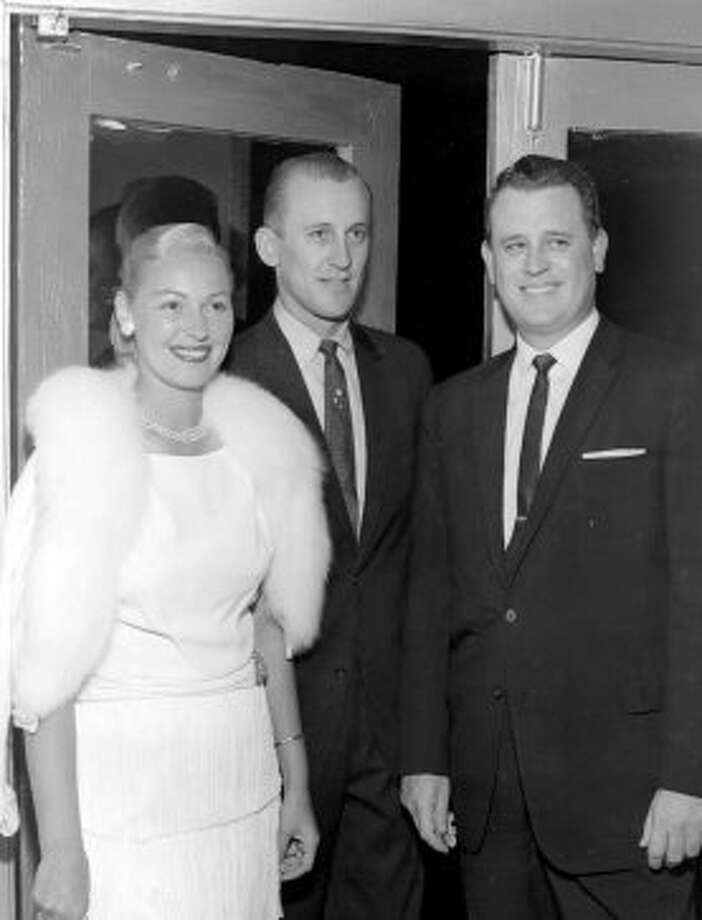 Dr. John HillThis case sounds like a movie script. A prominent Houston doctor faces murder charges when his socialite wife suddenly dies. Then the plot thickens. Joan Hill died following a brief, mysterious illness on March 19, 1969. Harris County prosecutors built a case against Dr. John Hill (shown above, at right), and he went on trial in 1971. But those proceedings soon ended in a mistrial when Ann Kurth, Hill's second wife, testified that he admitted killing Joan and even attempted to kill her as well. And before he could be tried again, the River Oaks plastic surgeon was gunned down as he and his third wife, Connie, returned home from out of town.
