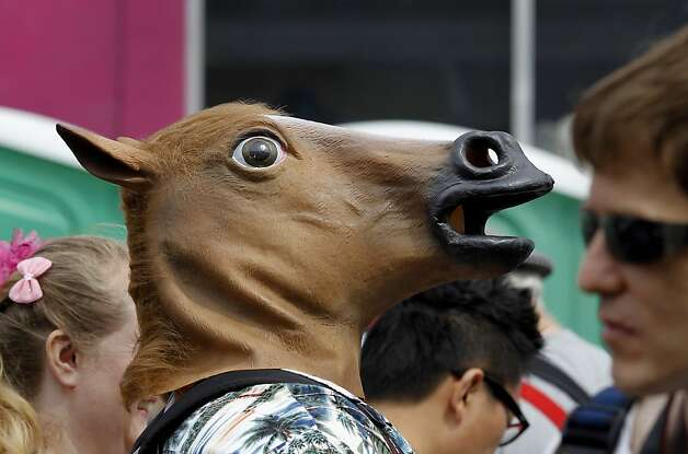 A fair goer wore a horse head as he/she paraded around. The 29th annual Folsom Street Fair in San Francisco, Calif between 7th and 12th Streets attracted thousands of participants and curious spectators to the sometimes outrageous theatre Sunday September 23, 2012. Photo: Brant Ward, The Chronicle
