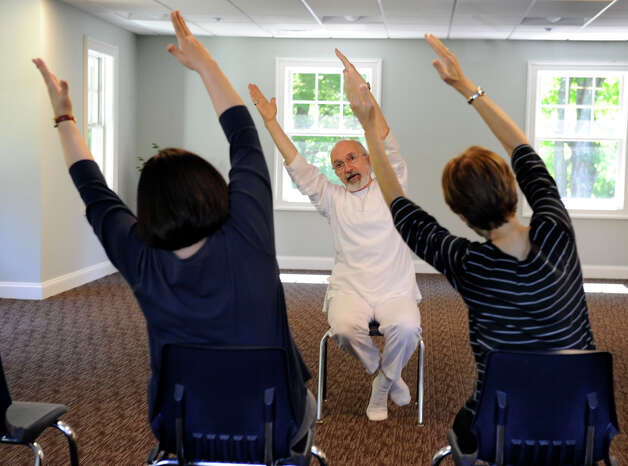 Joe Gillotti of Danbury teaches chair yoga at Ann's Place in Danbury Friday, Sept. 21, 2012. This is one of 20 programs Ann's Place offers to people living with cancer to aid in their rehabilitation and recovery. Photo: Carol Kaliff