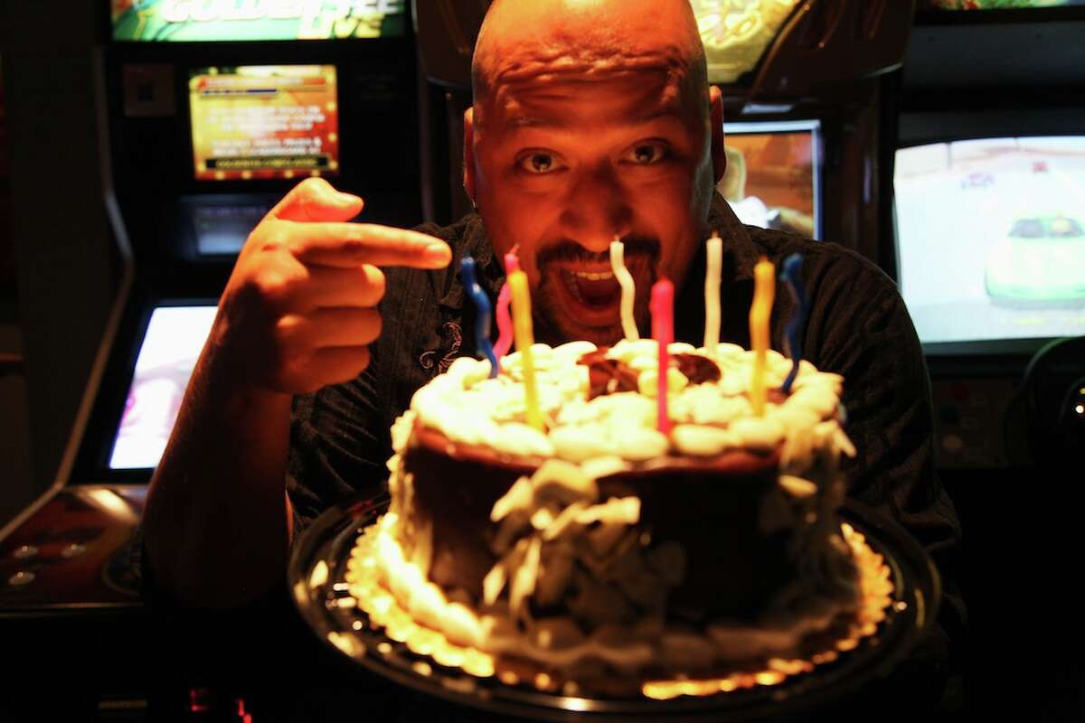 Tony Cortez with 94.1 KTFM is enjoying his birthday cake at Knife and Fork Gastropub.