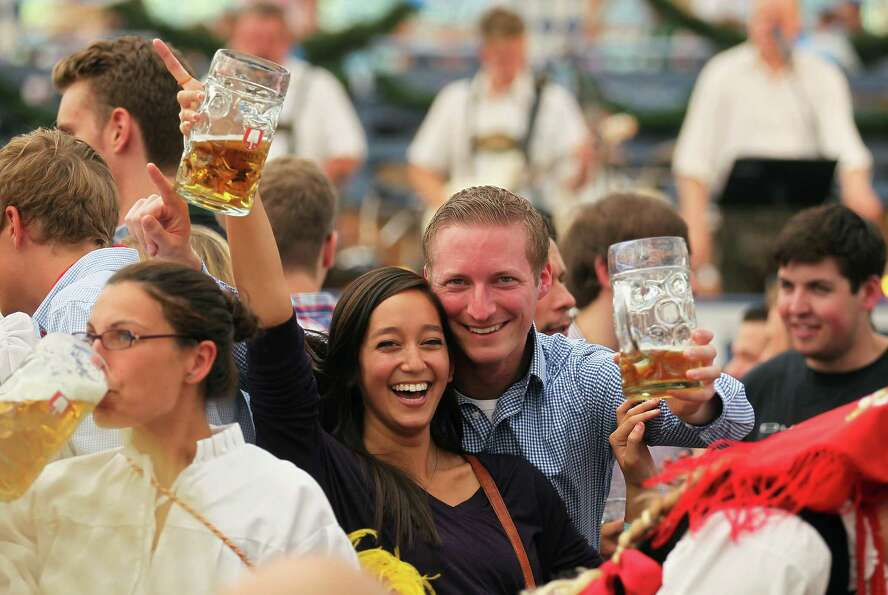 Revelers celebrate at Schottenhamel beer tent during the second day of Oktoberfest beer festival on