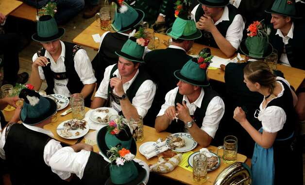 Participants of the Oktoberfest folklore parade rest in a beer tent.  (AP Photo/Matthias Schrader) Photo: Ap/getty