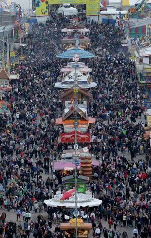 General view at the Oktoberfest beer festival after opening in Munich, southern Germany. The world's largest beer festival, to be held through Oct. 7. (AP Photo/Matthias Schrader) Photo: Ap/getty