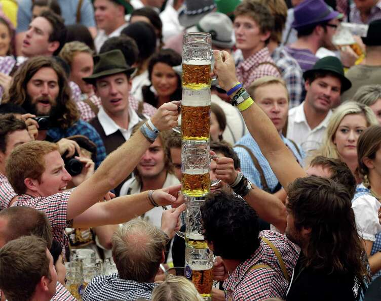 Young people celebrate the opening ceremony in the Hofbraeuzelt  beer tent.  (AP Photo/Matthias Sch