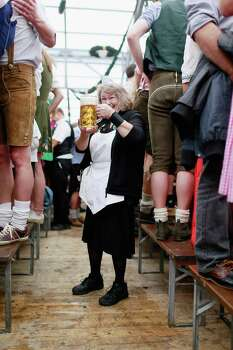 A waitress carries beer at Schottenhamel beer tent during Oktoberfest in Munich, Germany. This year's edition of the world's biggest beer festival Oktoberfest will run until Oct 7.  (Photo by Johannes Simon/Getty Images) Photo: Johannes Simon, Ap/getty / 2012 Getty Images