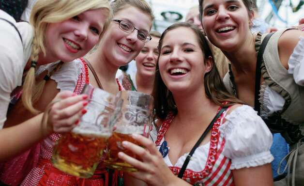 Revellers, dressed with traditional Bavarian clothes celebrate at Schottenhamel beer tent during Oktoberfest in Munich, Germany.  (Photo by Johannes Simon/Getty Images) Photo: Johannes Simon, Ap/getty / 2012 Getty Images