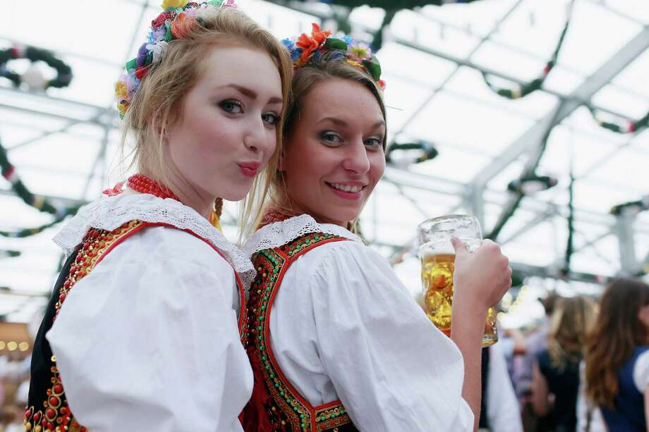 Polish women, dressed in traditional Polish clothing, celebrate at Oktoberfest.   (Photo by Johannes Simon/Getty Images) Photo: Johannes Simon, Ap/getty / 2012 Getty Images