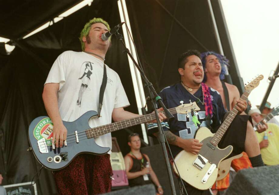Rumors flew that rockers Underoath may have took NOFX's Fat Mike (far left) ribbing too seriously, as the band left the Warped Tour shortly after. Fat Mike's jokes were aimed at Underoath being Christians.  Photo: D. Fahleson, Houston Chronicle / Houston Chronicle