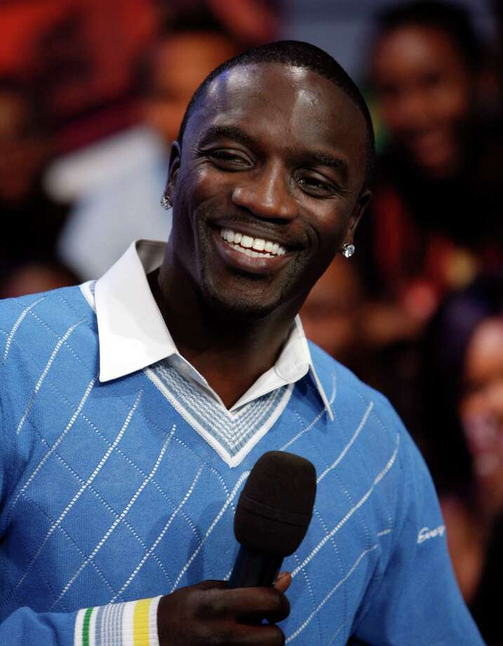 "Akon acted as his own security during his infamous ""fan toss incident."" He actually threw a fan off the stage.  Photo: Jason DeCrow, AP / AP"