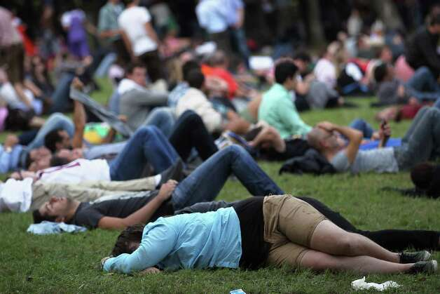 Drinkers rest after a day at the beer tents.  (Photo by Johannes Simon/Getty Images) Photo: Johannes Simon, Ap/getty / 2012 Getty Images