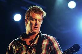 BRISBANE, AUSTRALIA - MARCH 30: Josh Homme of Queens of the Stone Age performs on stage during the V Festival at Avica Resort on March 30, 2008 on the Gold Coast, Australia.
