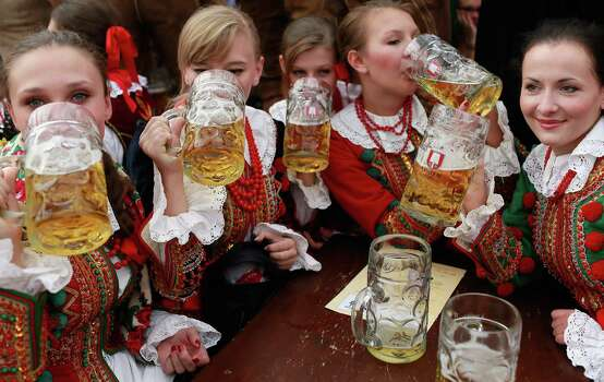 Polish women, dressed in traditional Polish clothing, raise a glass at Oktoberfest.  (Photo by Johannes Simon/Getty Images) Photo: Johannes Simon, Ap/getty / 2012 Getty Images