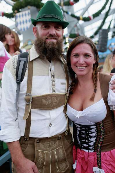 Revelers dressed with traditional Bavarian clothes celebrate at Schottenhamel beer tent during Oktob