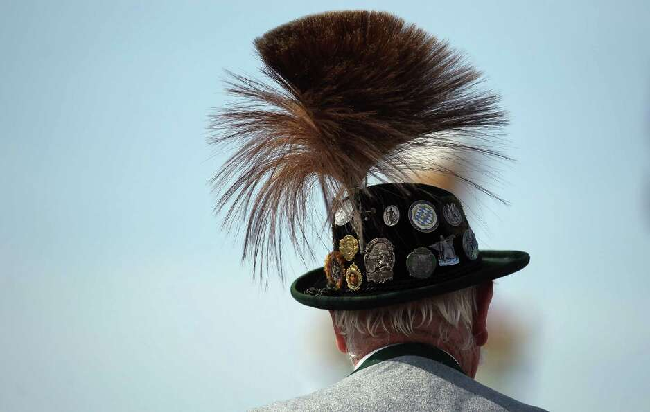 A member of a riflemen's association wears a traditional Bavarian Gamsbart hat during the riflemen's