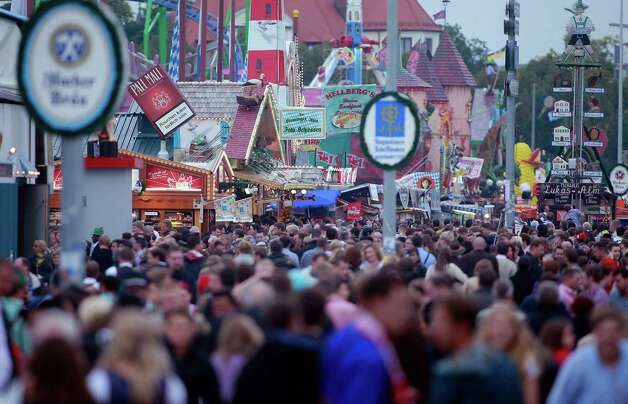 People attend Oktoberfest near Hofbraeuhaus beer tent in Munich, Germany.  (Photo by Johannes Simon/Getty Images) Photo: Johannes Simon, Ap/getty / 2012 Getty Images