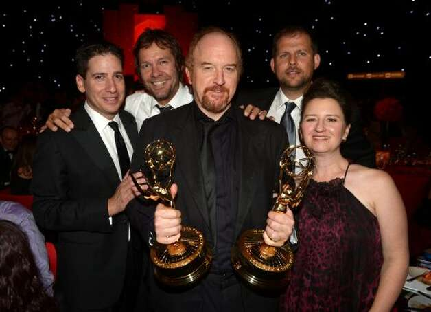 Comedian/actor Louis CK (C) and guests attend the 64th Annual Primetime Emmy Awards Governors Ball at Nokia Theatre L.A. Live on September 23, 2012 in Los Angeles, California.  (Kevin Winter / Getty Images)