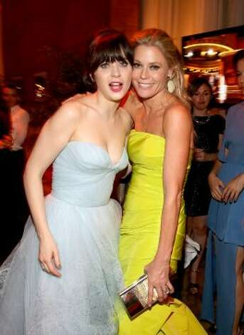 Actresses  Zooey Deschanel (L) and Julie Bowen attend the FOX Broadcasting Company, Twentieth Century FOX Television and FX 2012 Post Emmy party at Soleto on September 23, 2012 in Los Angeles, California.  (Christopher Polk / Getty Images for FOX)