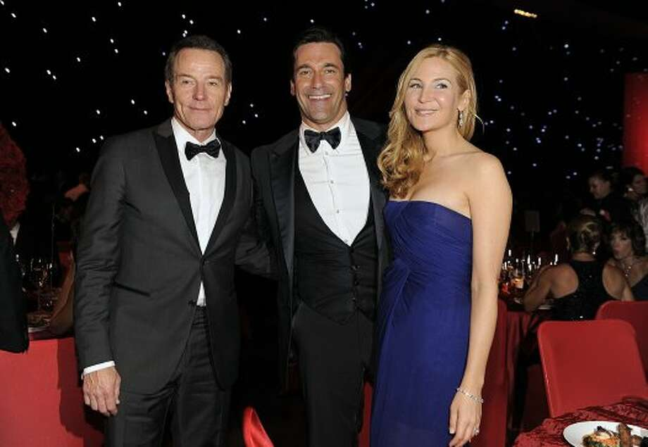 Bryan Cranston, left, posed with Jon Hamm and Jennifer Westfeldt, right, at the 64th Primetime Emmy Awards Governors Ball on Sunday, Sept. 23, 2012, in Los Angeles.  (Chris Pizzello / Associated Press)