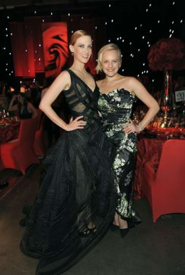 January Jones, left, and Elisabeth Moss pose for a photo at the 64th Primetime Emmy Awards Governors Ball on Sunday, Sept. 23, 2012, in Los Angeles.  (Chris Pizzello / Associated Press)