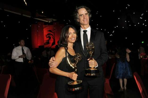 "Director Jay Roach, right, and his wife Susanna Hoffs pose with his awards for outstanding directing in a miniseries or movie and best miniseries or movie for ""Game Change"" at the 64th Primetime Emmy Awards Governors Ball on Sunday, Sept. 23, 2012, in Los Angeles.  (Chris Pizzello / Associated Press)"