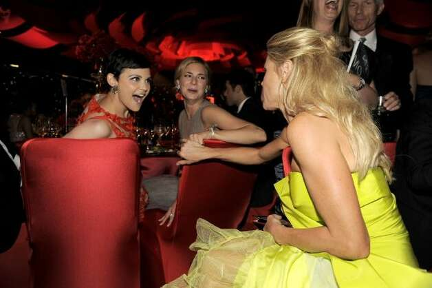 Ginnifer Goodwin, left, and Emily VanCamp, center, speak with Julie Bowen at the 64th Primetime Emmy Awards Governors Ball on Sunday, Sept. 23, 2012, in Los Angeles.  (Chris Pizzello / Associated Press)