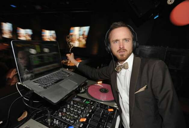 Actor Aaron Paul is seen in the DJ booth at the AMC Emmy After Party on Sunday Sept. 23, 2012, in Los Angeles.