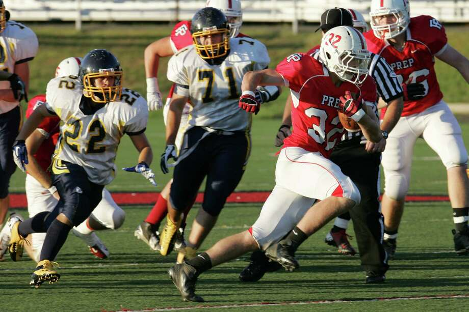 Fairfield Prep's # 32 Christopher Golger runs for a first quarter touchdown against East Haven on Friday. Prep would win 47-0. Photo: Mike Ross / Connecticut Post Freelance