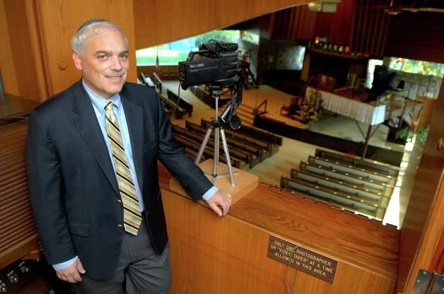 Rabbi Joshua Hammerman at Temple Beth El is setting up a service to webcast the high holy day services including Tuesday's Yom Kippur service to shut ins. He poses with the camera on Monday September 24, 2012 in Stamford, Conn. Photo: Dru Nadler / Stamford Advocate Freelance