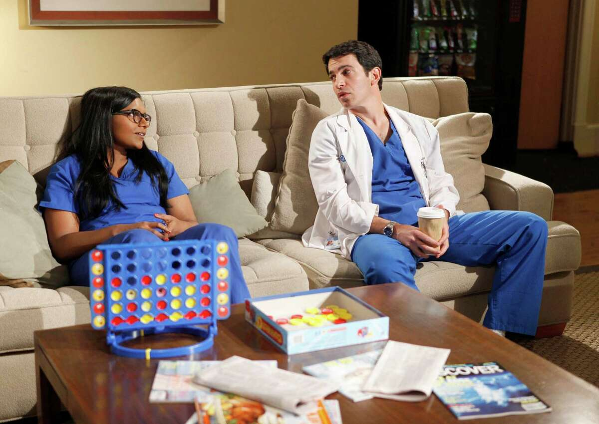 Mindy (Mindy Kaling, left)) and Danny (Chris Messina) watch a romantic comedy together in the new comedy