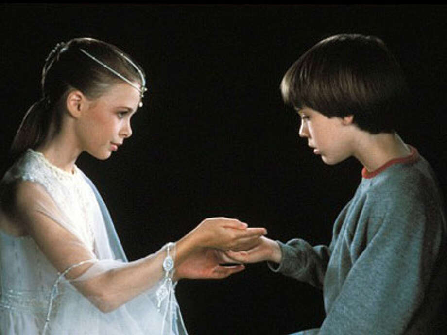 "Tami Stronach (left) and Barret Oliver star in ""The Neverending Story."" Photo: Warner Bros."