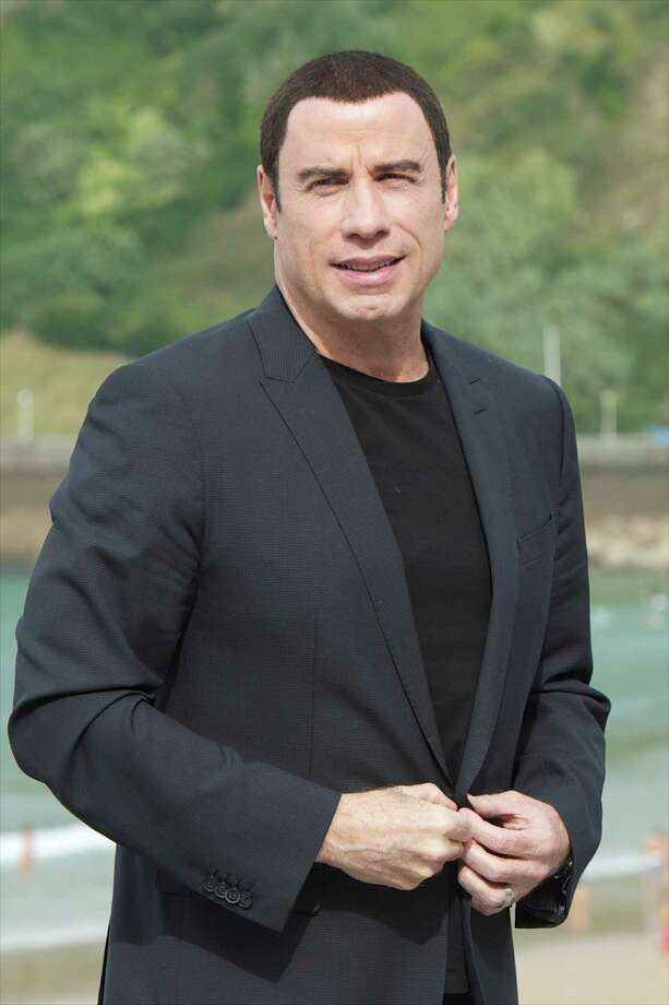 Actor John Travolta says he almost retired from acting after the death of his son, Jett, in 2009. Photo: Getty Images / 2012 Getty Images