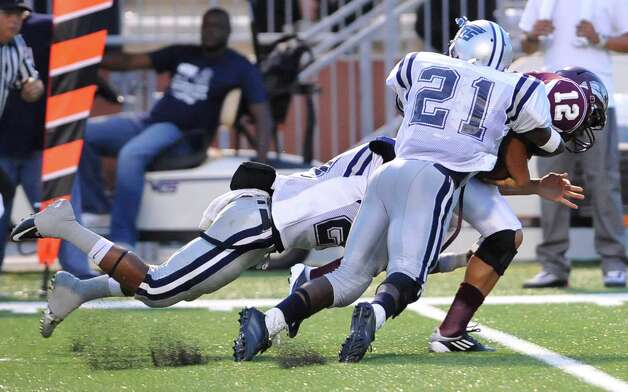 "West Orange-Stark linebacker #21, Colin Janice, center, helps take down a Central ball runner  during the game Friday night, September 14, 2012,  against Central Medical Magnet High School at the Carrol A ""Butch"" Thomas Educational Support Center.   Dave Ryan/The Enterprise Photo: Dave Ryan"