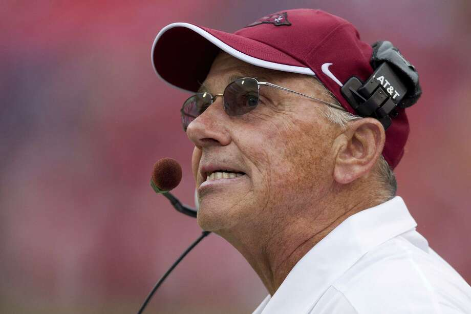 Arkansas coach John L. Smith is striving to maintain a positive attitude amid the Razorbacks' 1-3 start. Photo: Wesley Hitt, Getty Images / 2012 Getty Images