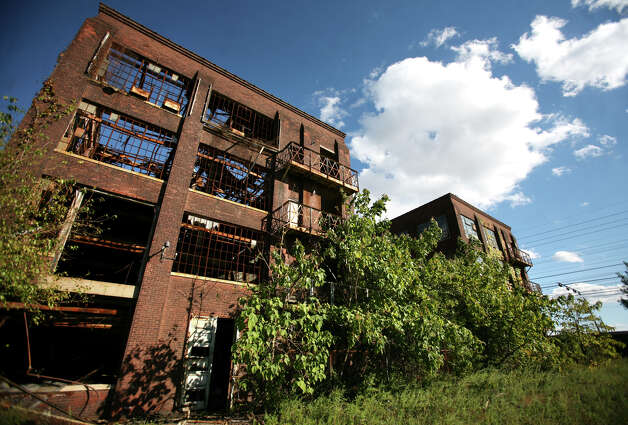 A derelict factory property abutting the tracks, site of the proposed new train station on Barnum Ave on Bridgeport's East Side on Monday, September 24, 2012. Photo: Brian A. Pounds / Connecticut Post