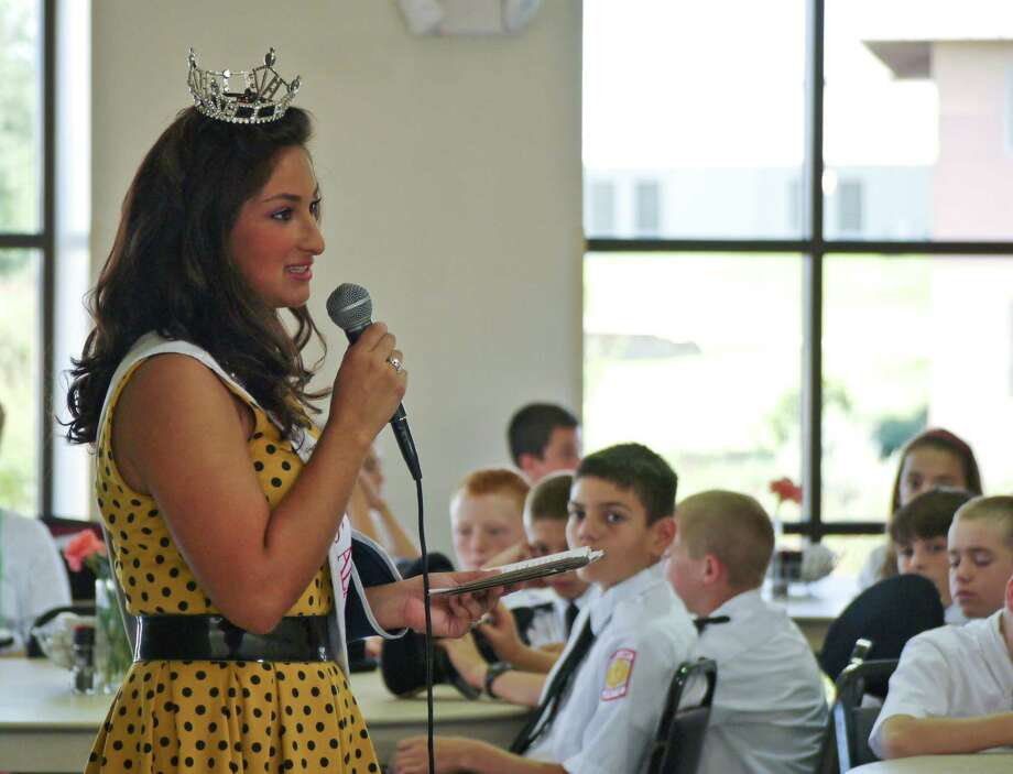 Miss Alamo CityÕs Outstanding Teen Presley Price, a sophomore at Brandeis High School, shares her  views on how to stop bullying with middle-schoolers at TMI Ð The Episcopal School of Texas. Photo: Courtesy Photo