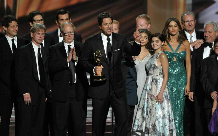 "Steven Levitan, center, and the cast and crew of ""Modern Family"" accept the outstanding comedy series award at the 64th Primetime Emmy Awards at the Nokia Theatre on Sunday, Sept. 23, 2012, in Los Angeles. (Photo by John Shearer/Invision/AP) Photo: John Shearer"