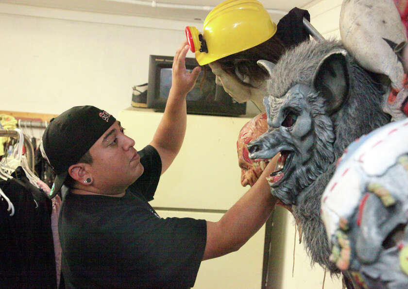 Adam Preciado, general manager of Nightmare on Grayson Street, works on a mask for the upcoming even