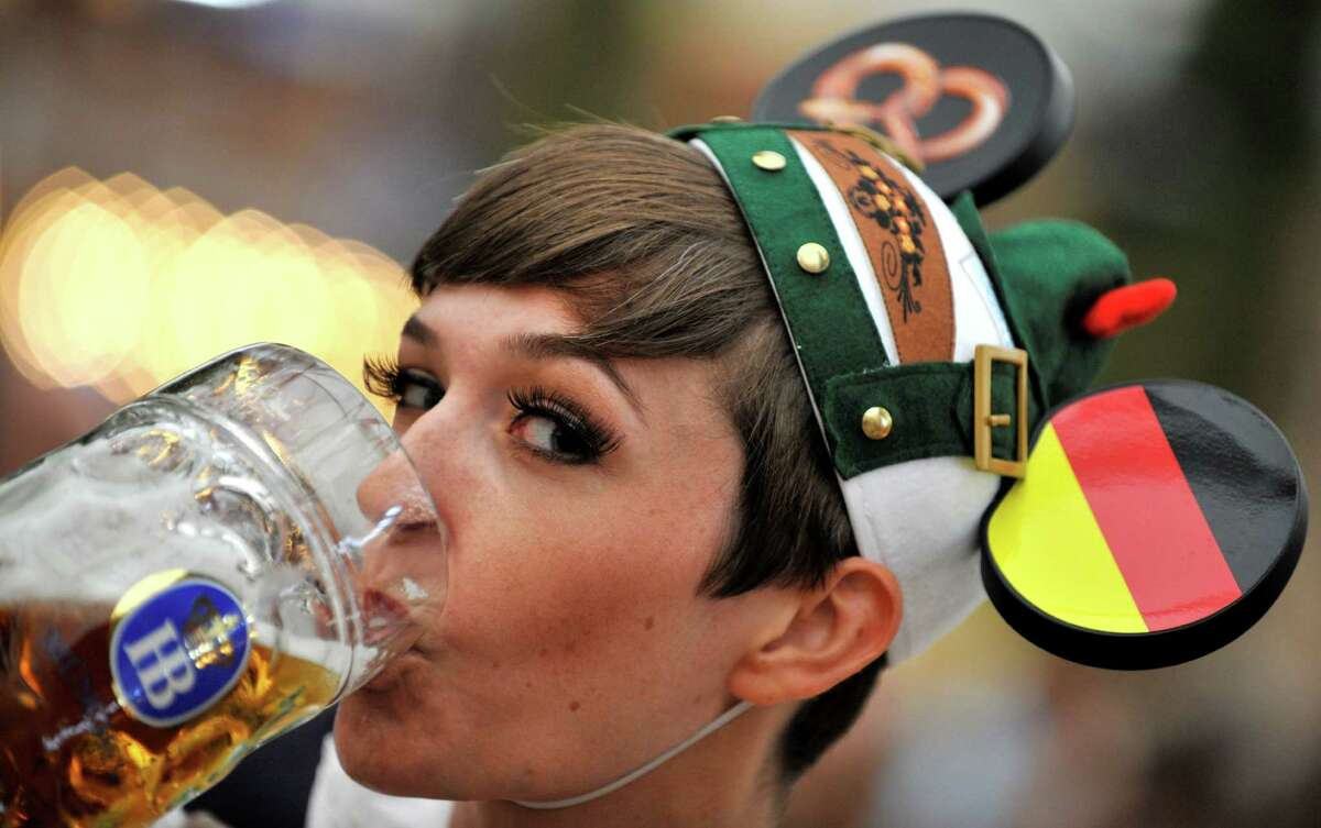 A young woman drinks a beer at the Theresienwiese Oktoberfest fair grounds in Munich, Germany, on Monday. The world's biggest beer festival Oktoberfest will run until Oct. 7.