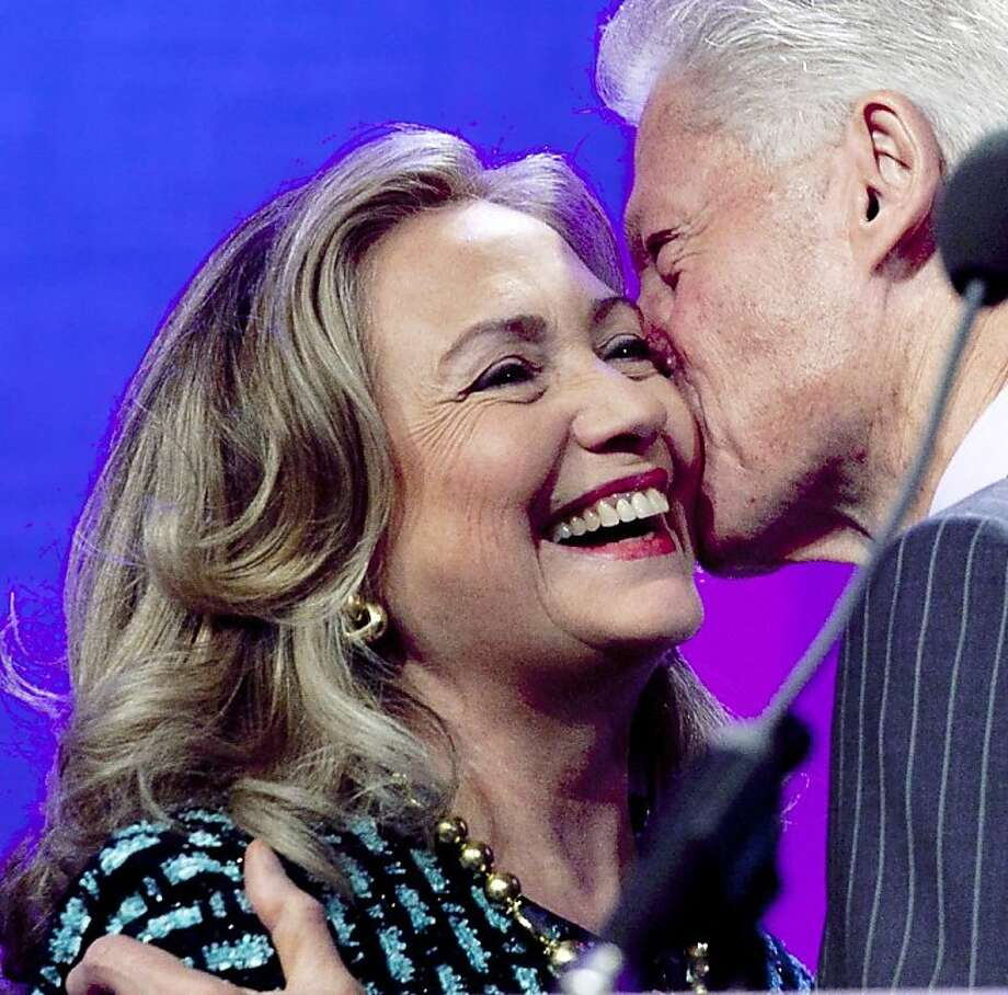 William Chafe argues that dysfunction in the Clintons' family backgrounds provided the impulse to serve in the public sphere. Photo: Mark Lennihan, Associated Press