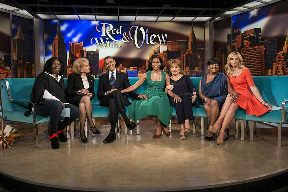 "Whoopi Goldberg (left), Barbara Walters, President Obama, Michelle Obama, Joy Behar, Sherri Shepherd and Elisabeth Hasselbeck gather for a taping of ""The View"" in New York. Photo: Brendan Smialowski, AFP/Getty Images"