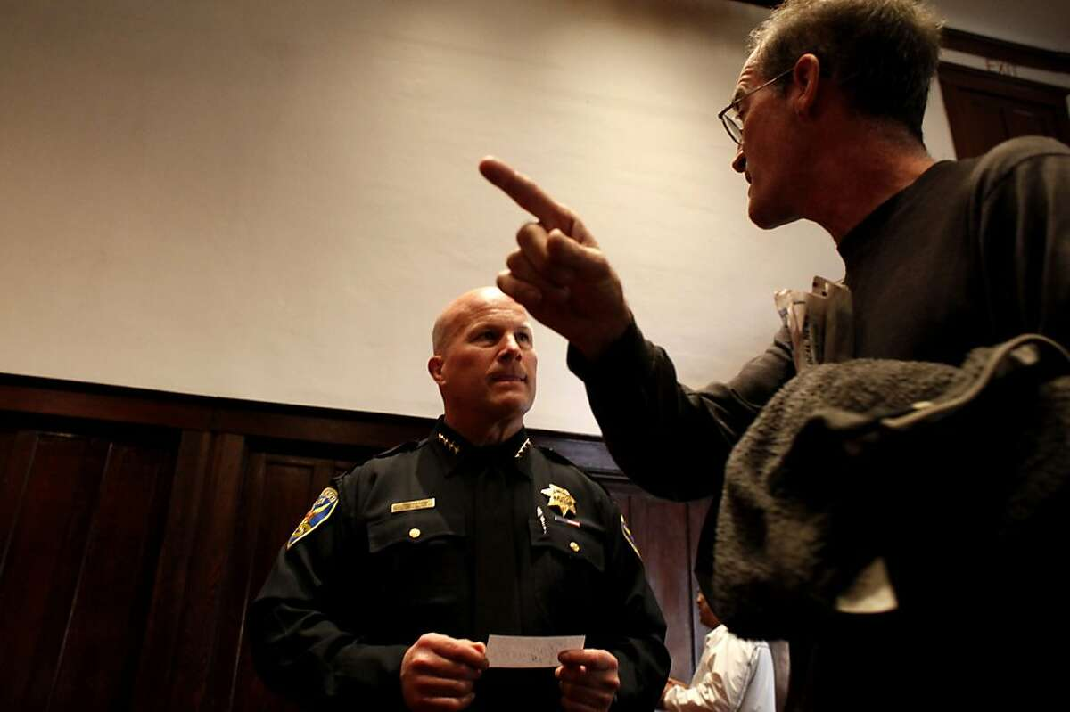 Resident Ralph Lane, left, asks San Francisco Chief of Police Greg Suhr a question regarding officers living in the neighborhoods and would that help with the crime, duirng a community meeting, Monday Sept. 24, 2012 to discuss last week's non-fatal officer involved shooting, in San Francisco, Calif. The shooting was the subject of last weeks protests which broke out into destruction of several businesses in the Mission District.
