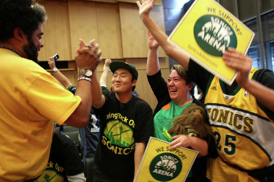 Seattle SuperSonic supporters, from left, Kris Brannon, Joseph Chong, Dawn Welch and Kenneth Knutsen celebrate as the Seattle City Council votes to approve an arena proposal on Monday, September 24, 2012 at Seattle City Hall. The vote helps pave the way for a future NBA and possibly NHL arena in Seattle. Photo: JOSHUA TRUJILLO / SEATTLEPI.COM
