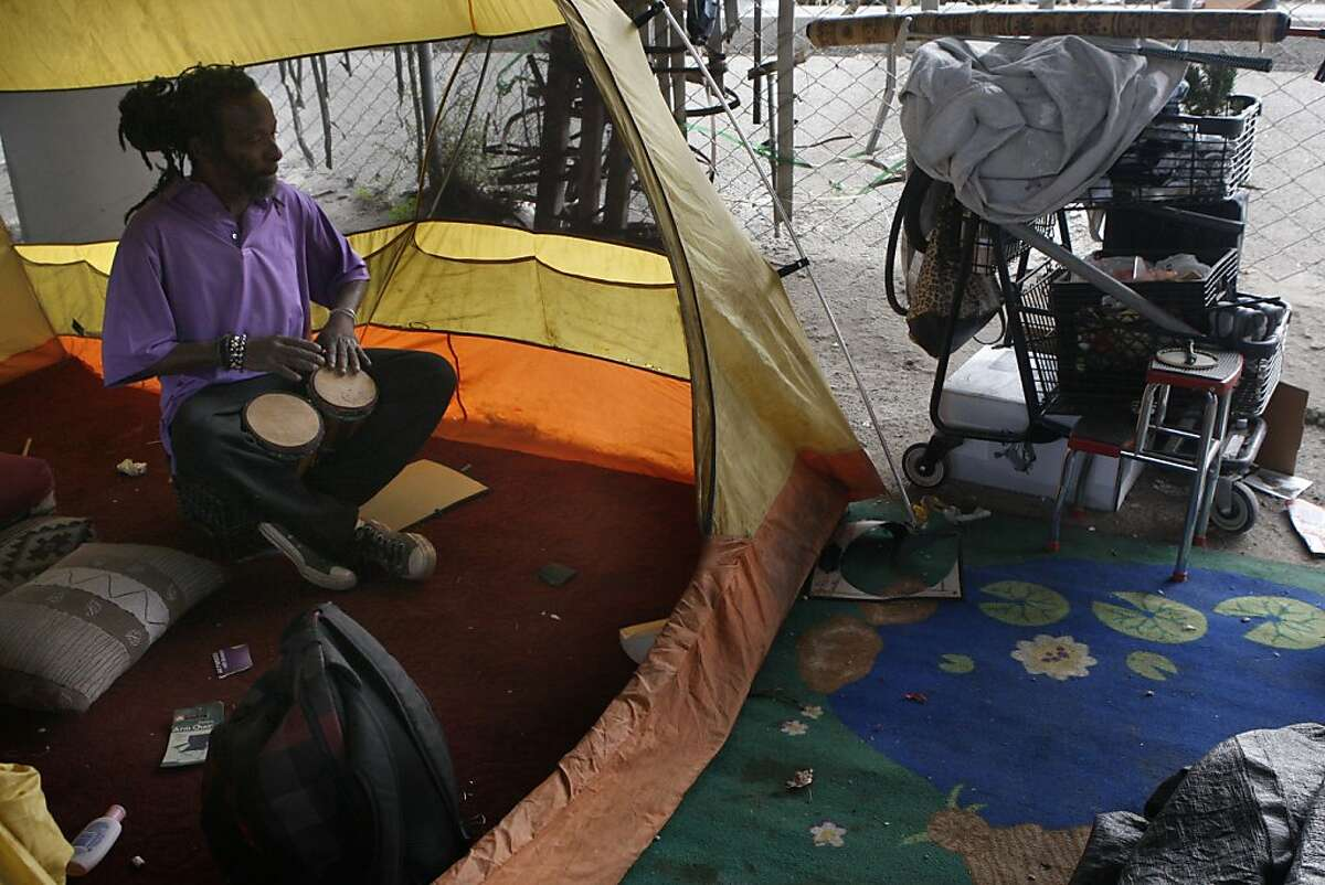 Rashan Hylton drumming in his tent at a homeless encampment under highway 280 on King at Fifth streets in San Francisco, Calif., on Monday, September 24, 2012. A past vocalist and musician, he has been living in the encampment for two years.
